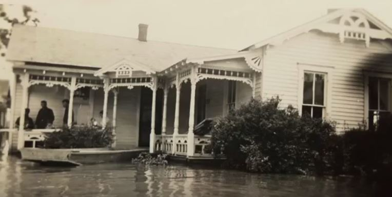 A house in the 1940s with water right up to the front porch.