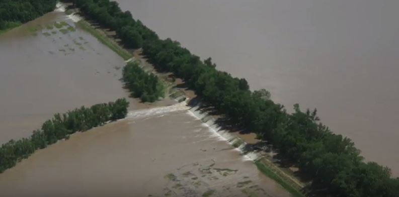 An aerial view of historic floods in a rural community.