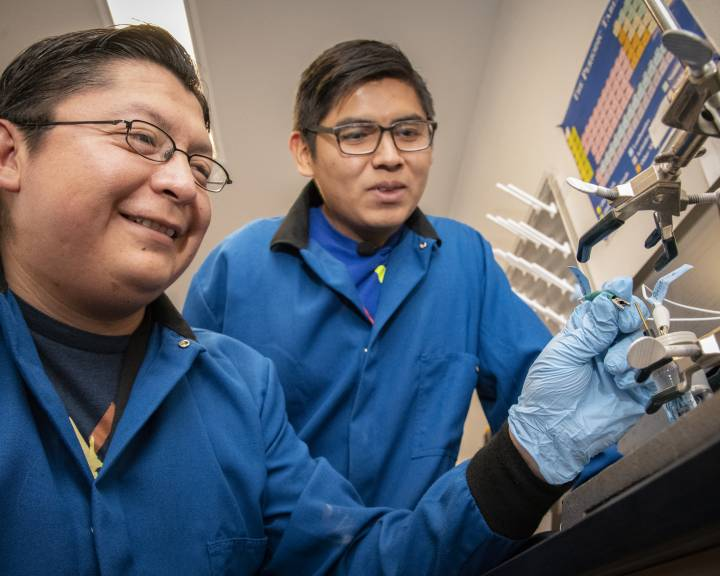 Two Native American researchers in a laboratory