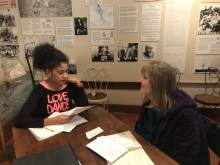 A student interviews a community resident at a local museum