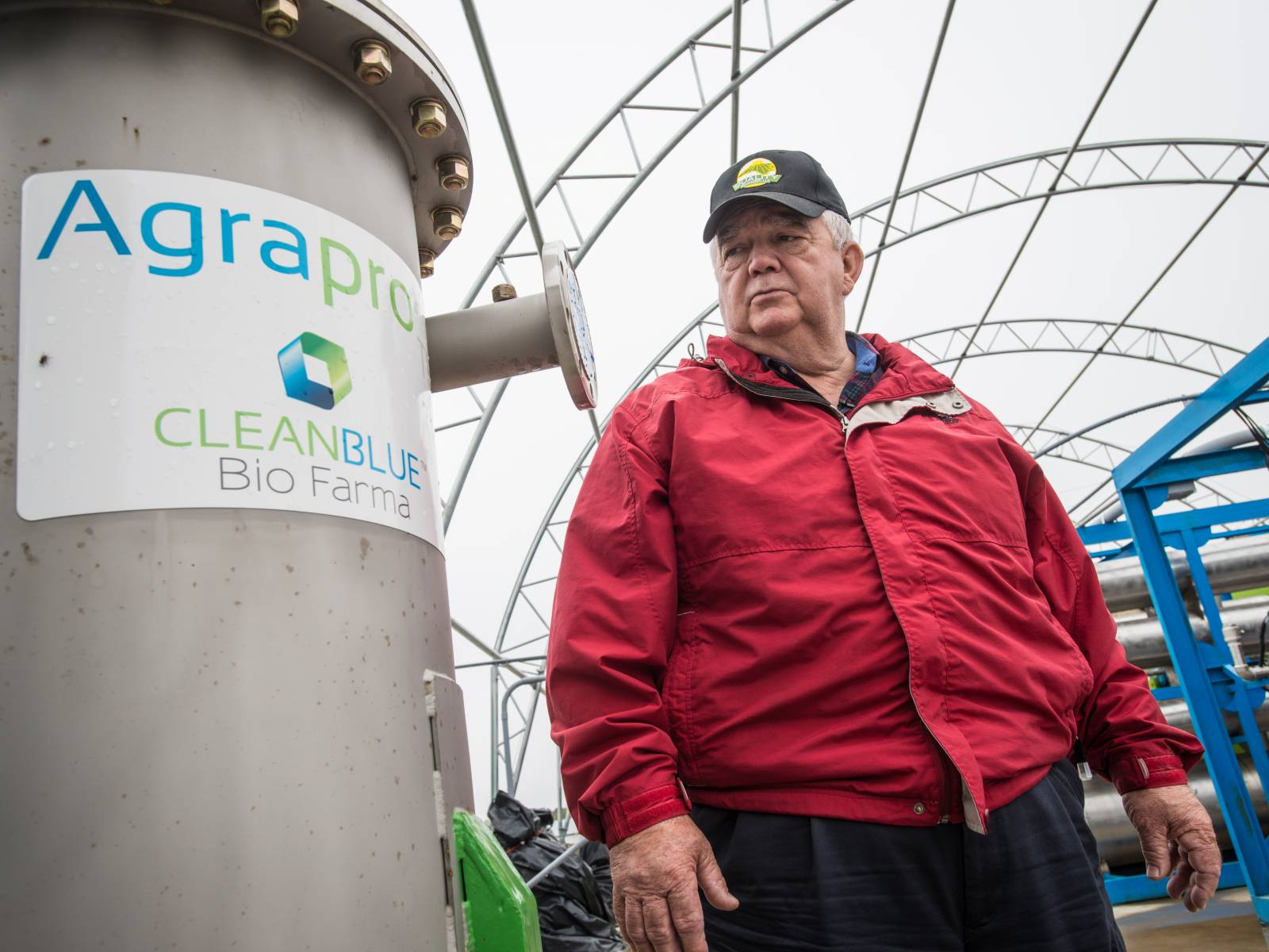 A farmer uses a renewable energy system fueled by farm wastes