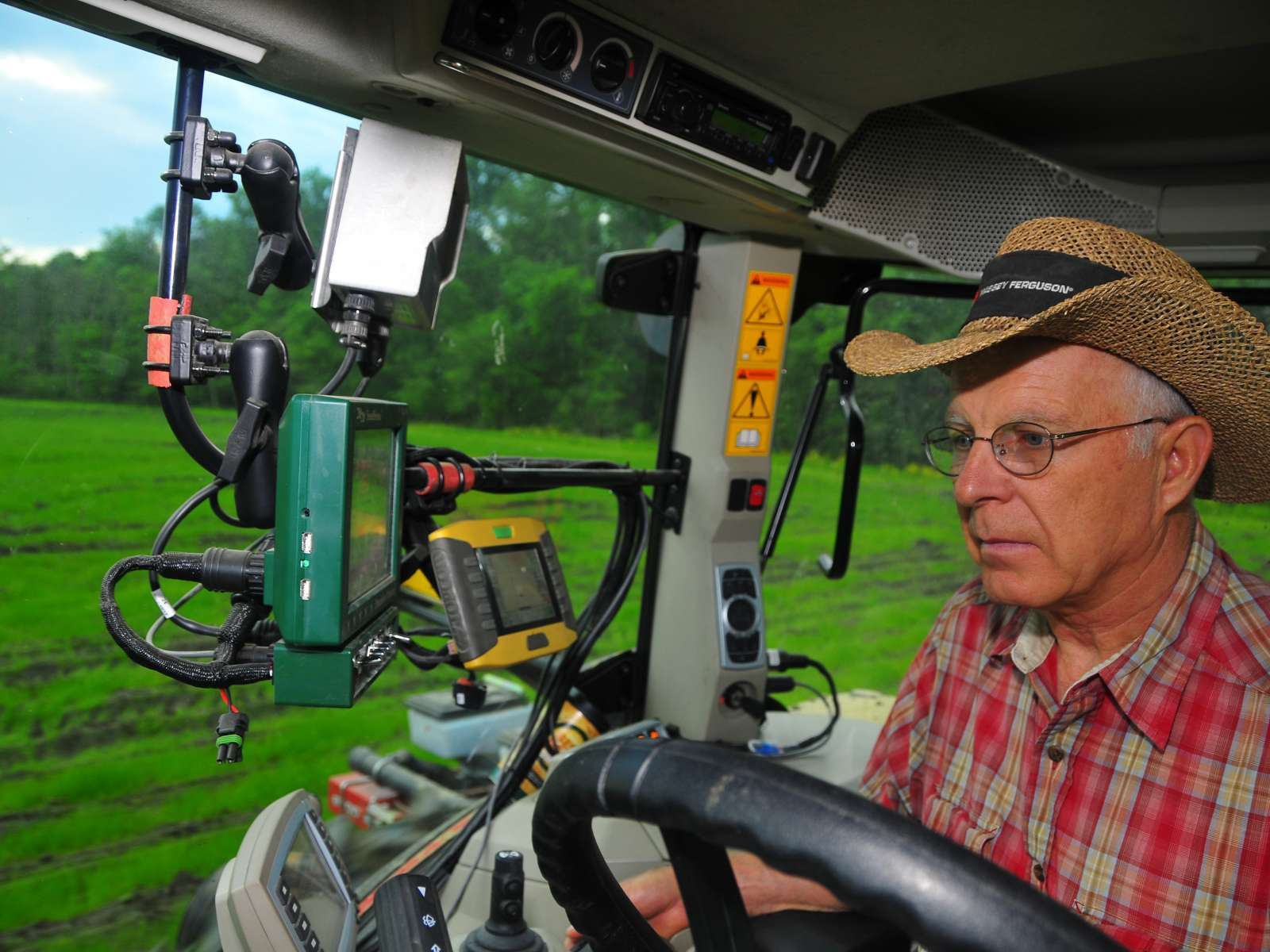 Farmer using technology in tractor