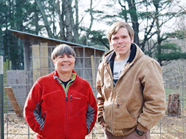 Both wearing jackets, Carol and Dave on the farm.