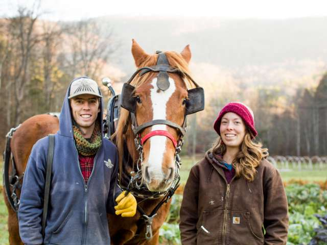Jacob Crigler and Kara Dodson pose with a horse on their farm.