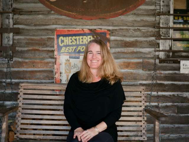 Lisa Cooper sits on a swing at the Mast General Store.