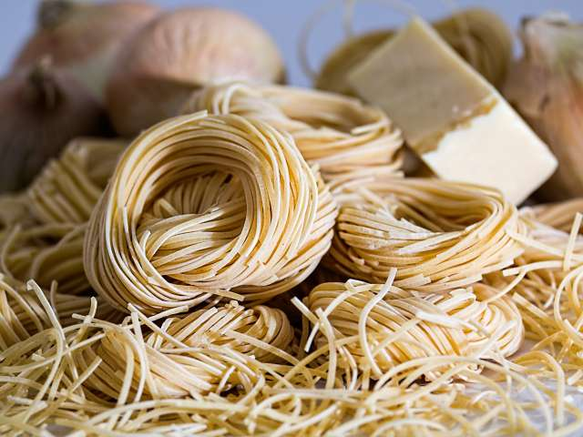 Dried noodles wrapped in bundles. Pexels