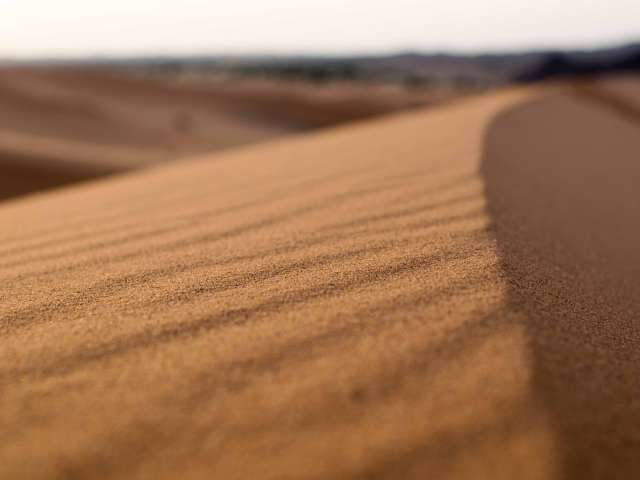The surface of a desert sand dune. Pexels
