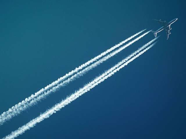 A photo of a jet plane and its contrails. Pexels