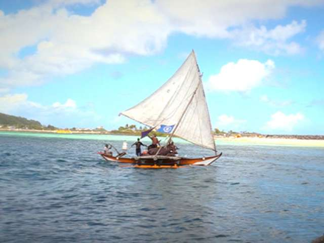 Sailing in a double-hulled canoe