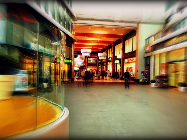 The inside of a shopping mall in a blurred, artsy photo.