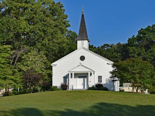 A rural church in a pastoral setting.