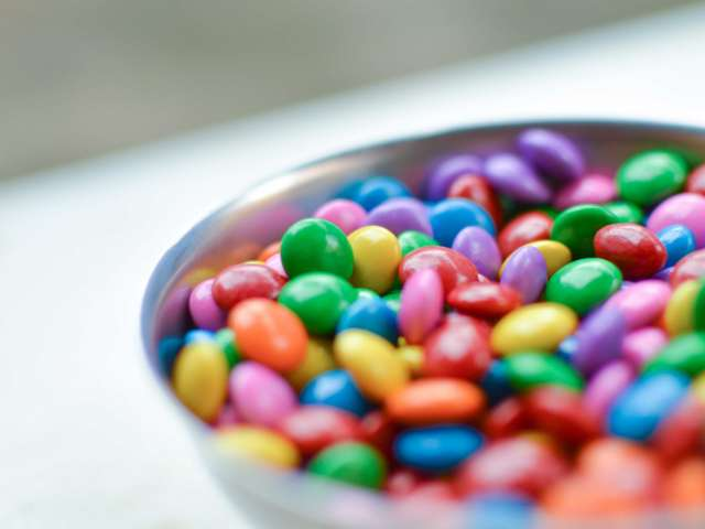 A bowl full of colorful candy-coated chocolates.