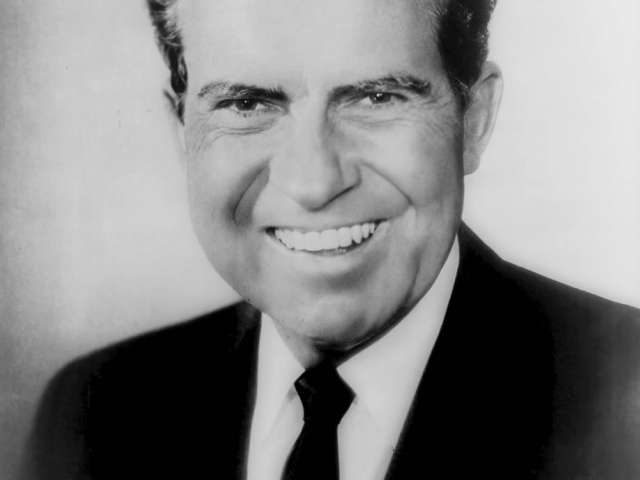 A black-and-white image of Richard Nixon in a suit and tie.