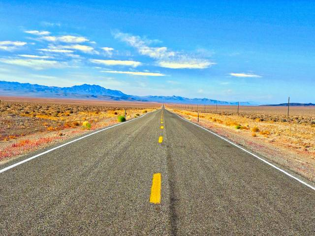 A beautiful stretch of secluded mountainous highway in Nevada.