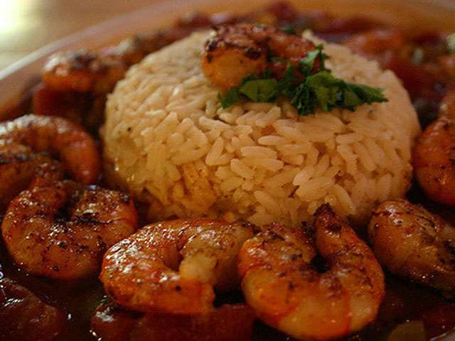 A plate full of shrimp and rice.