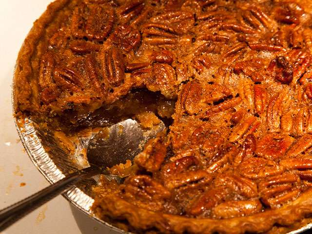 A fresh scoop out of a home-made Pecan pie. Photo by Joey Rozier. Flickr Creative Commons