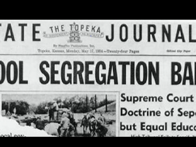 The front page of a 1966 local newspaper that reads, School Segregation Banned.