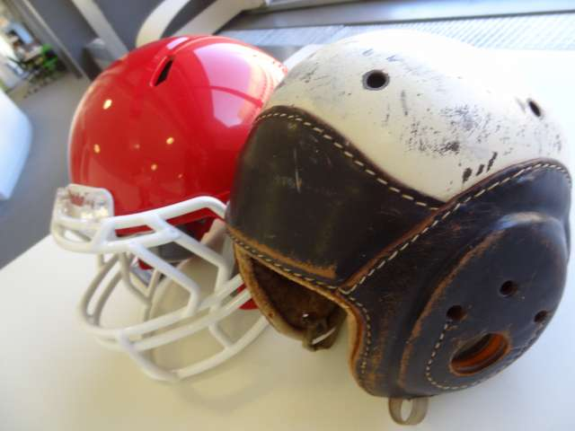 Football helmets in the Hometown Teams exhibition.
