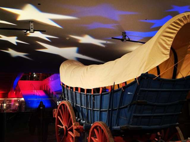 """Lights from an Evening Event Over Our Conestoga Wagon,"" by National Museum of American History. Flickr Creative Commons. Attribution Non-Commercial. www.flickr.com/photos/nationalmu…st-ahaxCs-noqFwX-"
