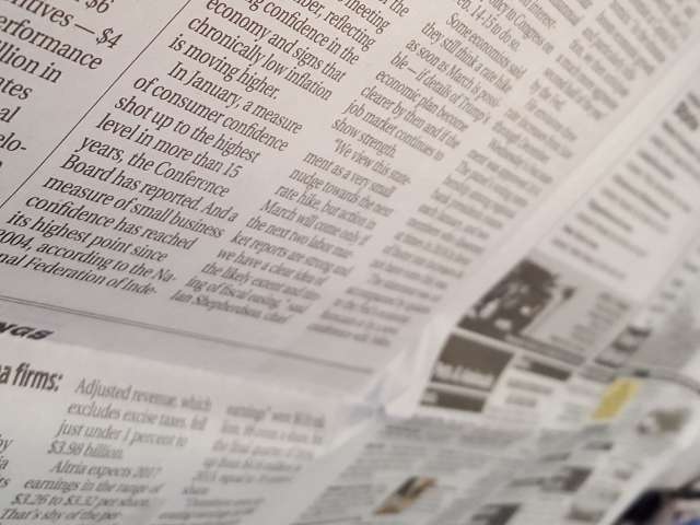 A close-up view of an open newspaper.