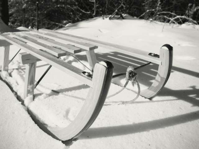 Old-fashioned sled in black-and-white photograph