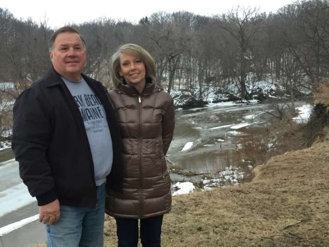 Don and Becky Waskosky stand by the banks of the Le Sueur River in Minnesota during winter. Courtesy Minnesota Humanities Center