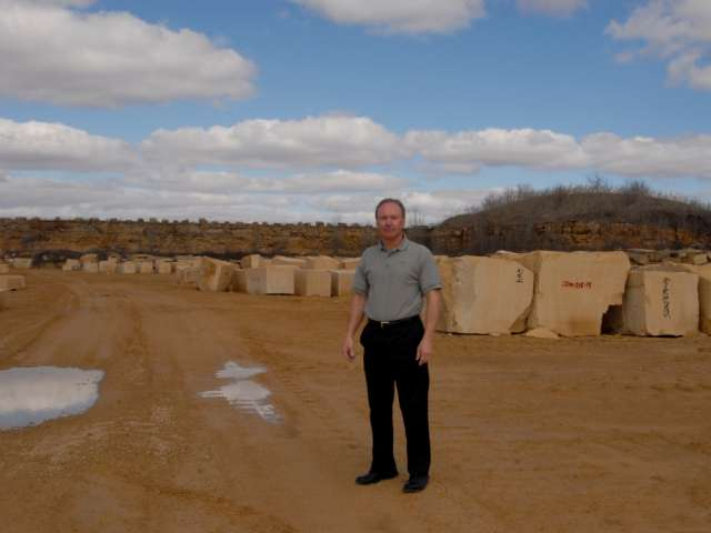 Donn Vetter stands among blocks of stone at the Vetter Stone Company in Minnesota. Courtesy Minnesota Humanities Center.