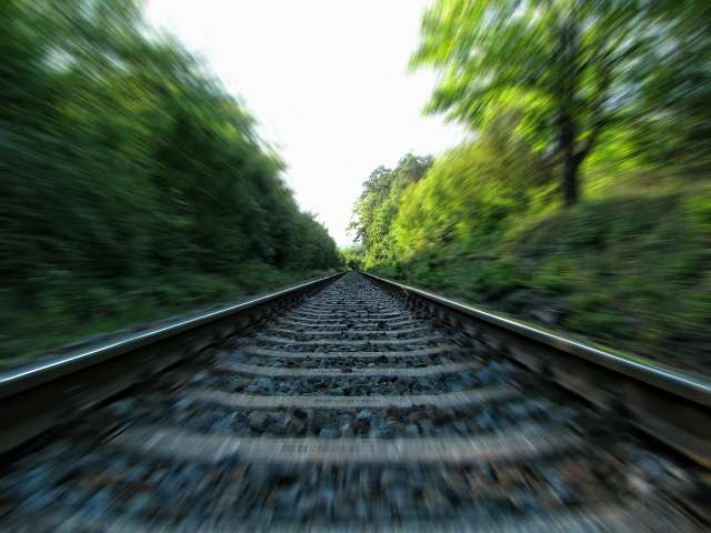The fast movement of a railroad tracks speeding by.