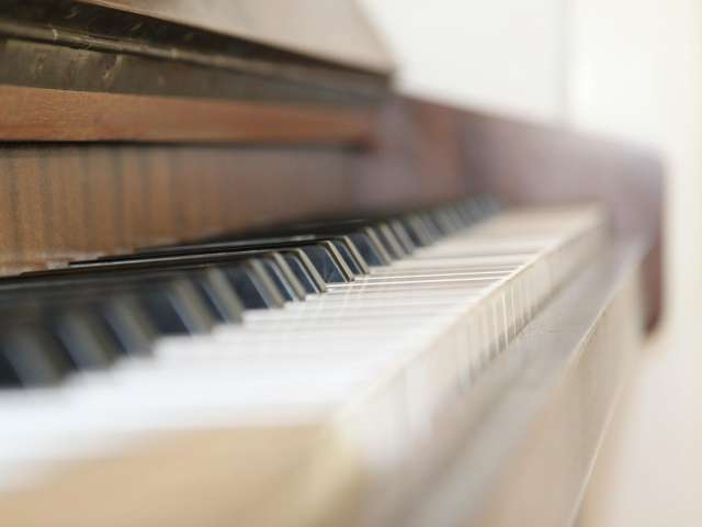 A detail of a piano keyboard. Pexels stock photo