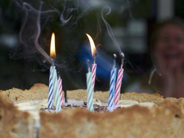 A close-up view of candles on a birthday cake. Pexels stock photo