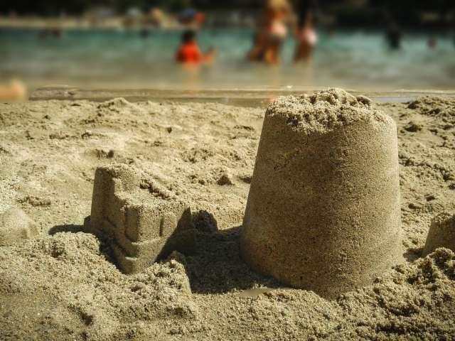 Sandcastles on a beach. Pixabay stock photo