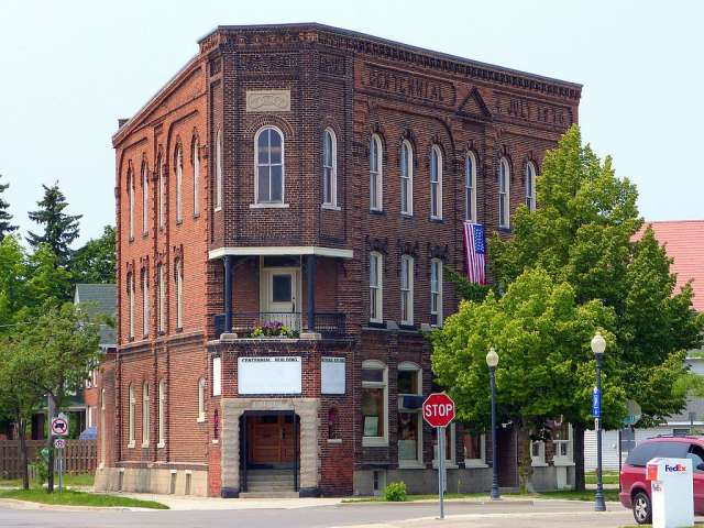 Photo by Ian Poellet of the historic Centennial Building (built 1876) in Alpena, Michigan, United States. Wikimedia Commons. Creative Commons Attribution-Share Alike 4.0 International license.