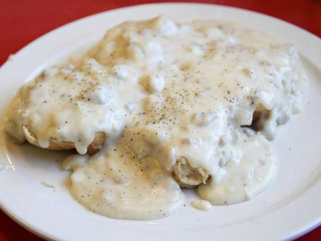 A plate of biscuits, smothered with gravy. Biscuits and Gravy by Jennifer Durban. CC Attribution Non-Commercial